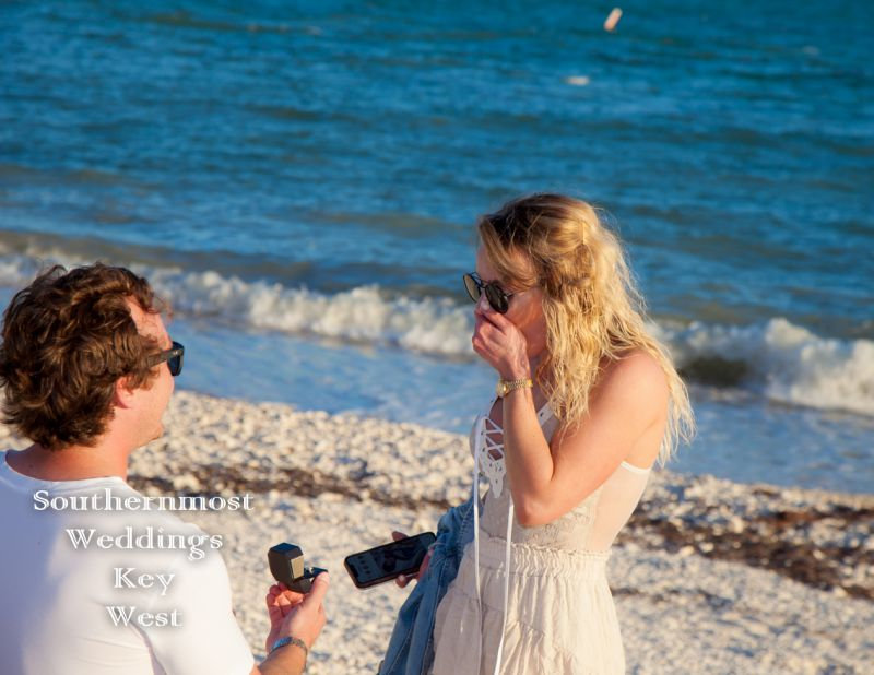 A man proposes to his girlfriend on the beach in Key West Florida