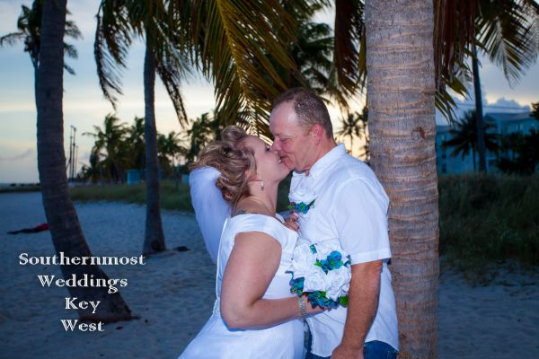 Wedding couple kissing on Smathers Beach - Image by Southernmost Weddings