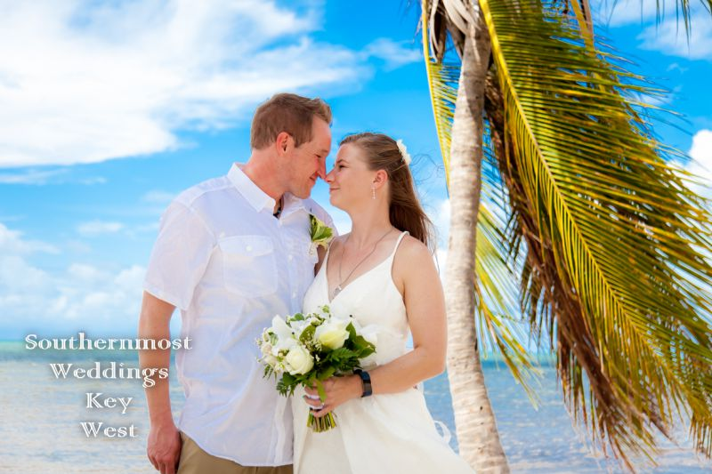 Wedding couple on the beach after getting married in Key West, Florida