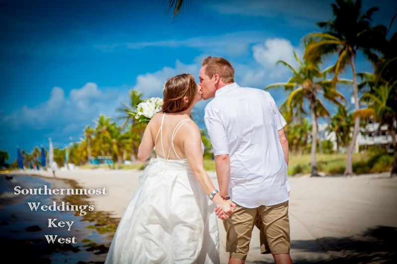 Wedding Couple kiss after getting Married on Smathers Beach by Southernmost Weddings Key West