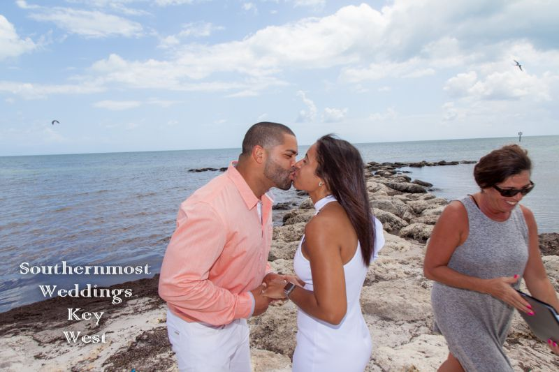 Wedding couple kiss on the beach after getting married in Key West, Florida by Southernmost Weddings
