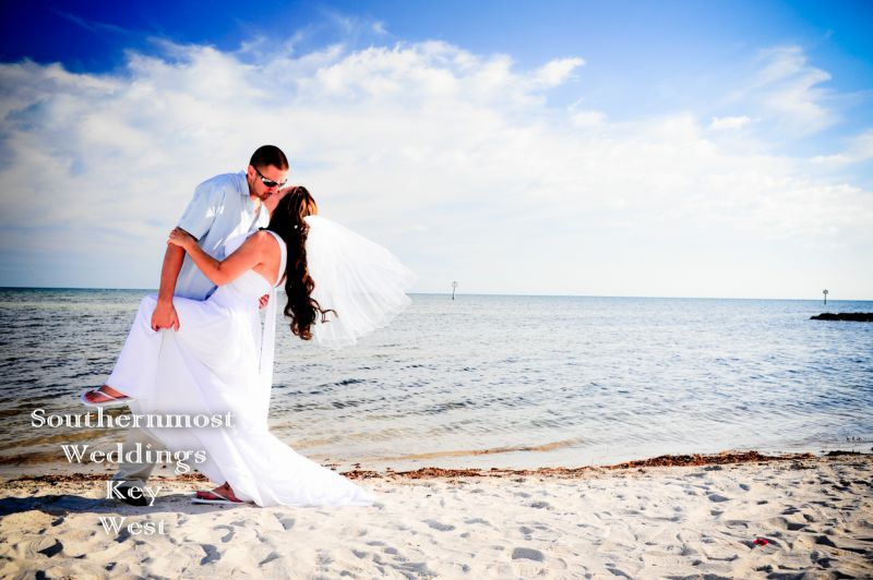 Wedding couple kisses on the beach by Southernmost Weddings Key West